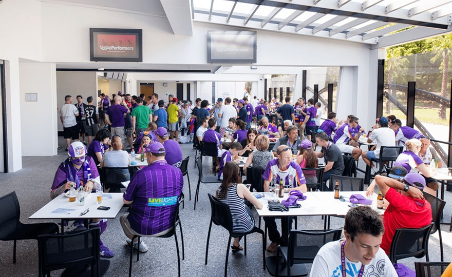 Perth Glory members enjoying corporate hosptality on the BBQ terrace.png